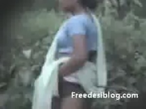 Indian aunty pissing outdoor