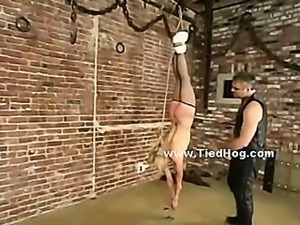 Fat man in leather takes his sex slave tied in chains and torments her in...