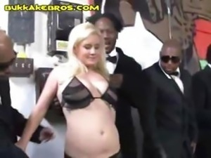 Interracial blow job gang bang of a blonde for a bunch of tux wearing black...