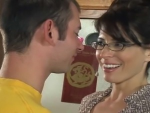 Very hot milf gets fucked on the kitchen table by younger dude. She likes...