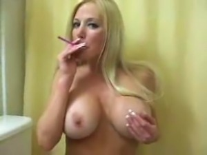Big Tit Blonde Smokes And Teases