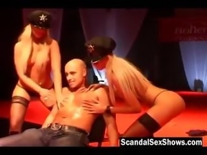 Two blonde female cops strip on stage
