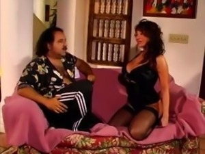 Ava Devine is a yummy chick with huge tits who gets ass fucked by Ron Jeremy
