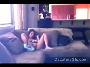 Yessie lies down on her couch with her legs wide open rubbing her pussy.