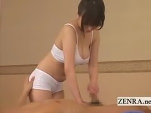 Busty Japanese sauna lady oil massage becomes handjob
