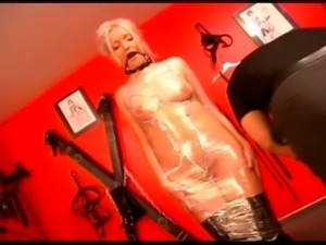 Sweet fem dom and willing slaves collude in this German fetish feature....