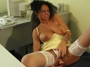 Big boobed ebony MILF enjoying some private time with her favorite toys.