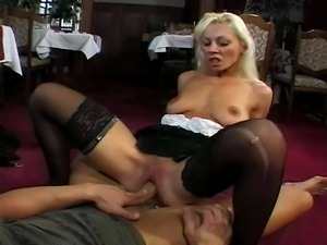 Blonde waitress serves more than just a dinner to her horny client.