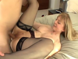 Big boobed cougar seduces in stockings and a garter