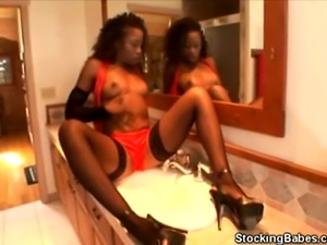 We have this hot ebony babe in her stockings as went in the powder room and...