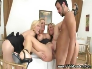 Clothed milfs start a reversed gangbang