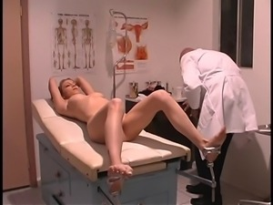 Doctor inserts speculum into pretty c-cup blonde's lubed twat