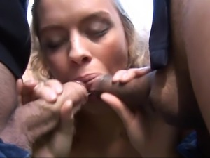 Sweet blonde blows on two cocks outside of the house. Then she bends over and...