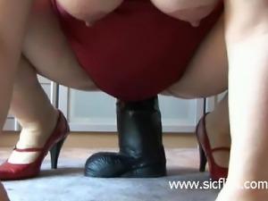 9 months pregnant slut fucks a gigantic dildo