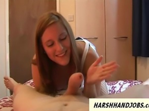 Younger girlfriend gives poor guy a harsh handjob in bedroom and slaps his dick