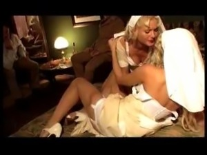 Nice MMFF clip with two blonde nurses sporting nice corsets and stockings...