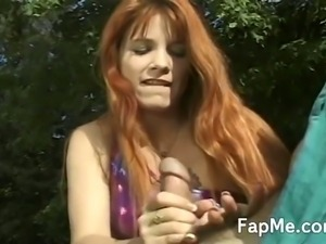 Sexy redhead jerking off a large dong