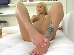 stunning blond gives footjob