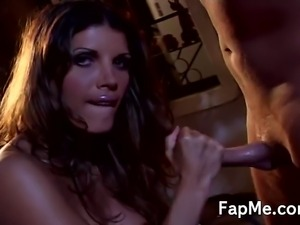 Horny brunette with huge breasts sucking and stroking a hard white dong