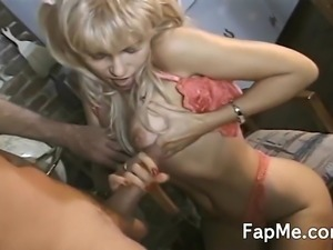 Stunning blonde is down on her knees sucking and playing with a long dong