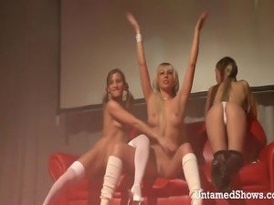 Three horny strippers in sexy outfits dildoing each others pussies