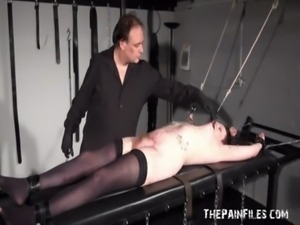 Stapled slaveslut in hardcore bdsm and severe pussy pain on the bondage rack...