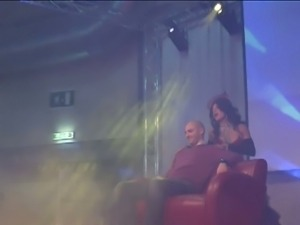Lucky guy joins stripper on stage