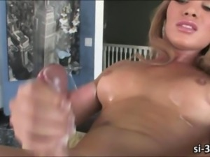Lusty shemale Aly Sinclair strokes cock