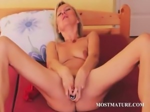 Mature hottie filling her pussy with a big vibrator