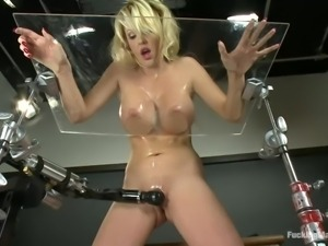 big oiled boobs blonde milf fucking herself on a desk