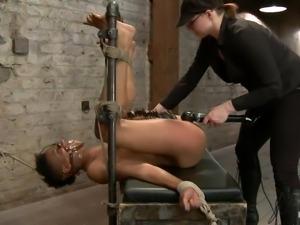 black vibrator on a tied black slut