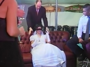 Bride in wedding dress gets a gangbang.
