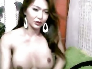 Asian Tranny plays with her Dick