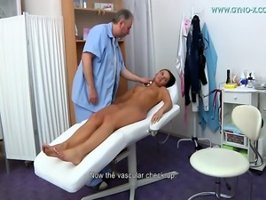 Young black-haired girl went to gynecologist. Full body examination with...