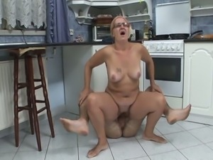 Horny granny sucks and fucks in kitchen