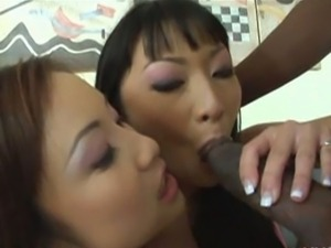 Asian lena and tia suck a big black cock