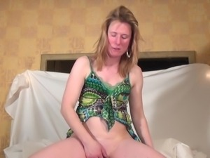horny mature stuffing her shaved vagina
