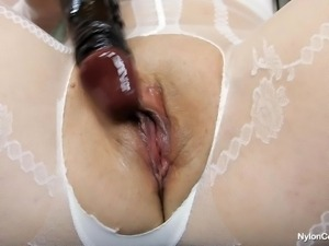 brunette slut penetrates her tight vagina with a big dildo