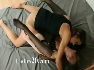 Young girls in nice dress sucking toy