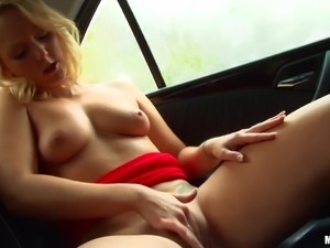 blonde milf fingers herself in the car