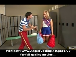 Adorable blonde teen cheerleader talking with her teacher