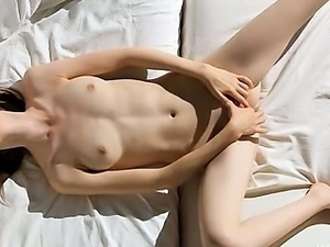 Super slim girl fingering her snatch
