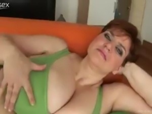 Chubby Busty Mature plays with her massive boobs and masturbate free
