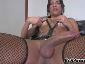 Raven haired tranny Jo Garcia with fake round tits and