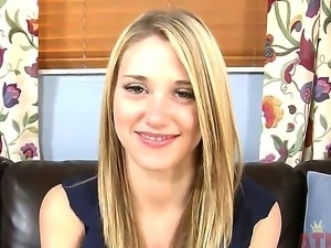Blonde Shelby Paige chats for a bit and starts to stimulate her pussy though...