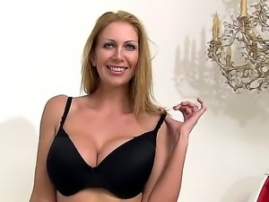 Sexy mature blonde woman Leigh Darby strips before fingering her shaved sweet...
