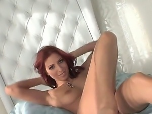 The beautiful and sexy redhead Cydel masturbates in front of camera her wet...