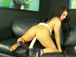 Pretty and seductive brunette Casey Cumz with a tattooed body penetrates her...