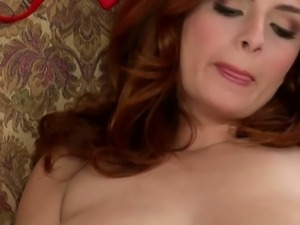 Glamorous redhead Ashley Graham with delicious big natural tits plays