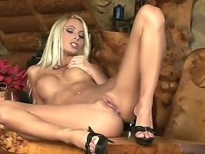 The attractive blonde pornstar Adelle masturbates and penetrates her wet...